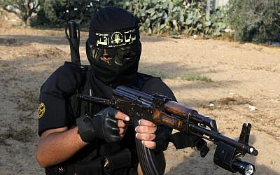 A masked fighter from Islamic Jihad's military wing takes part in a military drill in the southern Gaza Strip in May 2012. (photo credit: Abed Rahim Khatib/Flash90)