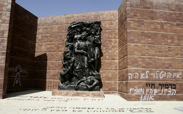 Vandals spray-painted a sculpture commemorating the Warsaw Ghetto uprising at Yad Vashem in June. The daubing reads: 'If Hitler hadn't existed, the Zionists would have invented him.' (photo credit: Uri Lenz/Flash90)