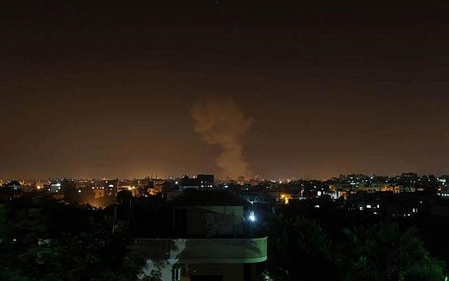 Smoke rises in Gaza after Israeli warplanes strike Hamas targets in June 2012. (photo credit: Majdi Fathi,@RichardDufek, Twitter)