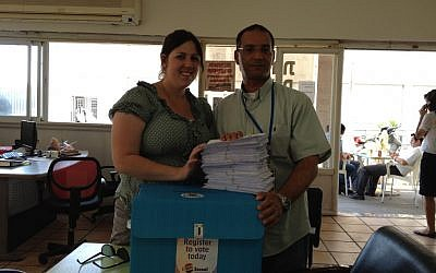An I Vote Israel staff member handing in 250 absentee ballots to the US embassy (photo credit: courtesy Elie Pieprz)