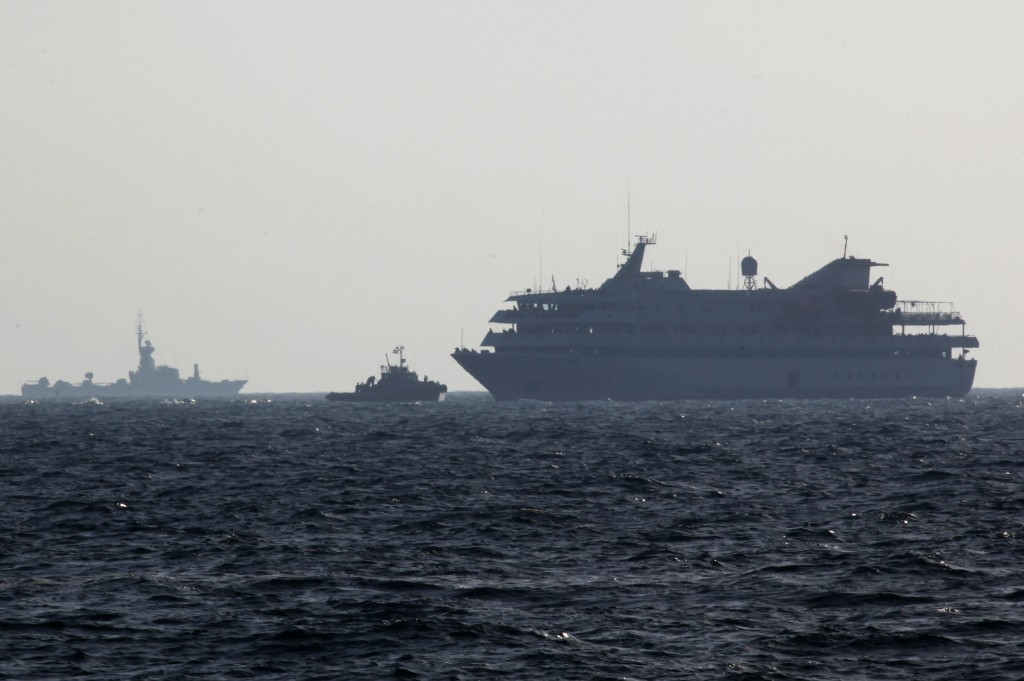 Navy vessels escort the Mavi Marmara to the Ashdod port on May 31, 2010. (photo credit: Kobi Gideon/Flash90)