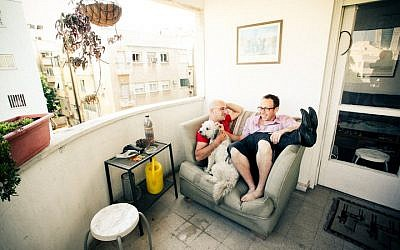 Elad David (right) and his husband Gil Diamant on their balcony in Tel Aviv (photo credit: courtesy)