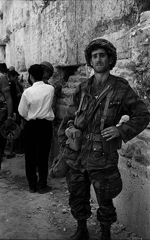 A soldier at the Western Wall on the day it was won; he does not seem to share the jubilant national mood (Photo credit: Copyright: Yossi Shemy/ all rights reserved)