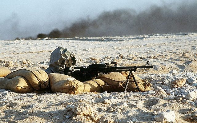 A Syrian soldier aims a light machine gun from his position in a foxhole during operation Desert Storm 20 years ago (photo credit: Tech. Sgt. H. H. Deffner/Department of Defense)