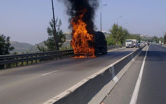 A burning truck on the Jerusalem-Tel Aviv highway, Thursday (photo credit:Times of Israel)