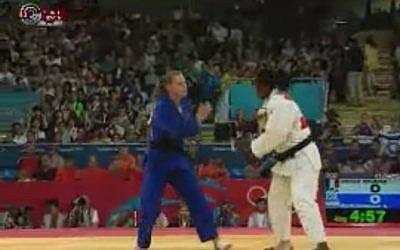 Israeli judoka Alice Schlesinger (blue) was eliminated from Olympic competition on Tuesday (photo credit: screen capture iba.org.il)