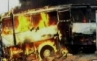 A tour bus that was attacked in the Bulgarian city of Burgas burns on Wednesday (photo credit: Channel 10 screen capture)