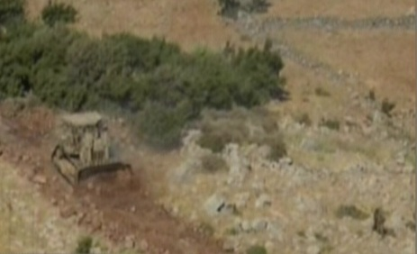 An IDF bulldozer works on the Golan Heights on Thursday (photo credit: Channel 10)