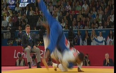 Israeli judoka Golan Pollack (in blue) fighting France's David Larose at the 2012 Olympic Games. (photo credit: Image capture from Channel 1)