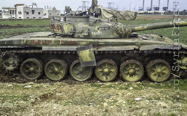 A destoryed Syrian Army tank. Russia has indicated it will not provide Assad with any new weapons. (photo credit: CC BY/FreedomHouse,Flickr)