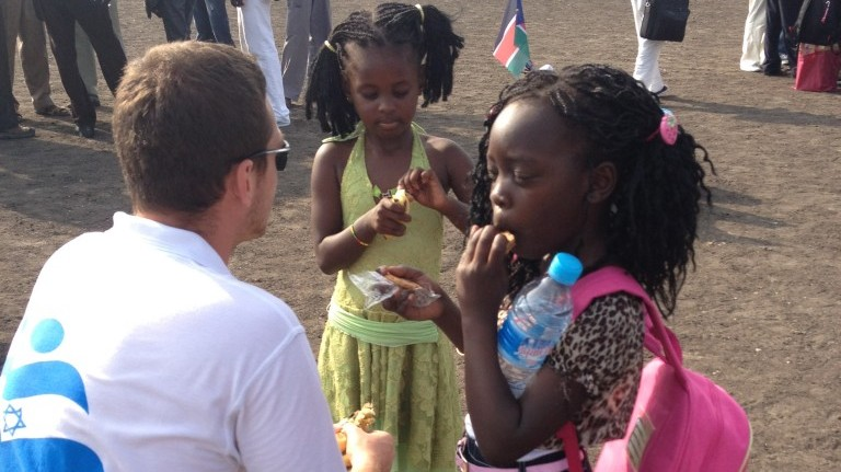 An IsraAid worker with Sudanese children. (photo credit: courtesy)