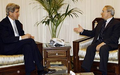 Farouk al-Sharaa, right, meeting with US Senator John Kerry in Damascus in 2009. (photo credit: AP/Bassem Tillawi)