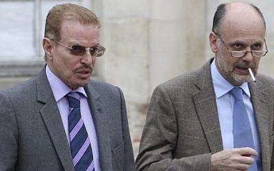 MIsmari (left) and his lawyer, 2011 (photo credit: AP/Michel Euler)