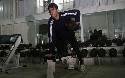 Palestinian athlete Baha Alfarra, who will compete the 400-meter Olympic race trains at a gym in Gaza City in March 2012 (photo credit: AP/Adel Hana)
