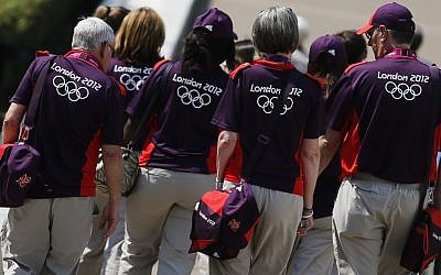 Volunteers arrive at Greenwich Park, the site for the equestrian and modern pentathlon events at the 2012 Summer Olympics, Wednesday, July 25, 2012, in London. (photo credit: AP Photo/Markus Schreiber)