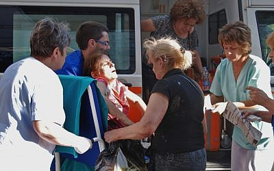 An unidentified injured Israeli tourist is carried in front of a Burgas hospital on Wednesday (photo credit: AP/ Bulphoto Agency)