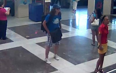 This image taken from security video provided by the Bulgarian Interior Ministry on Thursday, July 19, 2012, purports to show the Burgas bomber, center, with long hair and wearing a baseball cap, at Burgas Airport in Bulgaria, on Wednesday, July 18, 2012. (photo credit: Bulgarian Interior Ministry/AP)