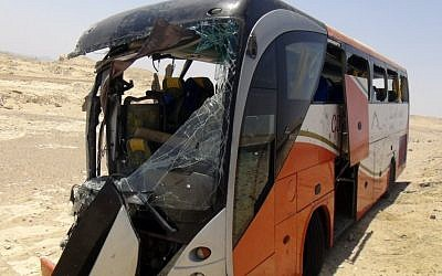 Illustrative: A man stands near a destroyed bus after a deadly crash near Hurghada, Egypt, Friday, July 20, 2012. (AP)