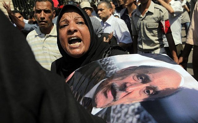 An Egyptian woman mourns Omar Suleiman at his funeral Friday (photo credit: AP Photo/Amr Nabil)