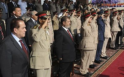 Mohammed Morsi stands amid soldiers in his inauguration ceremony June 30 (photo credit: AP Photo/Egyptian Presidency)