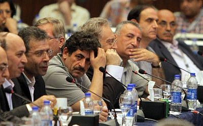 Exiled Syrian opposition figures meet in Cairo, Egypt, on Tuesday, July 3, 2012. (photo credit: Amr Nabil/AP)