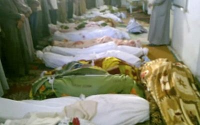 This image made from amateur video from Hama Revolution 2011 and accessed by AP video Friday, July 13, 2012 purports to show bodies of victims killed by violence that, according to anti-regime activists, was carried out by government forces in Tremseh, Syria. (photo credit: AP/Hama Revolution 2011 via AP video)