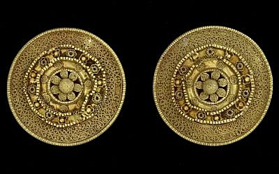 A pair of gold ear studs. 6th century BCE, with granulated discs forming a rosette (photo credit: Courtesy Bible Lands Museum)