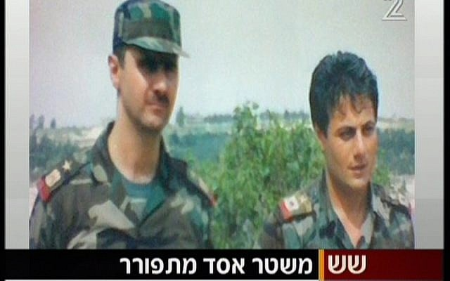 Bashar Assad, left, and Manaf Tlas seen in an undated picture. (Screenshot/Channel 2)