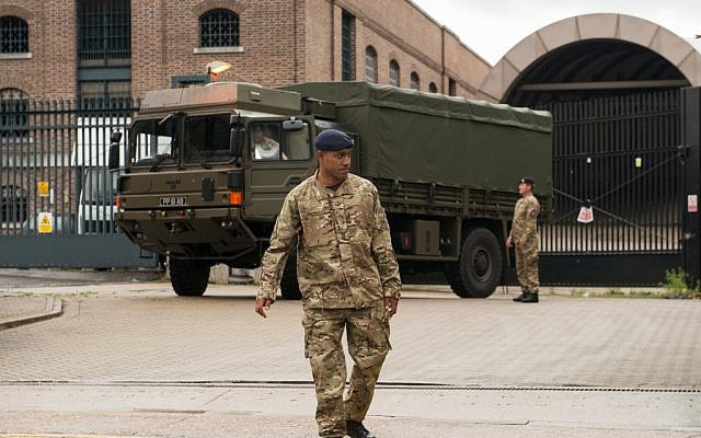 An army vehicle in east London with a few of  the 3,500 troops involved in keeping the 2012 Olympics safe, July 16 (photo credit: Dominic Lipinski/AP)