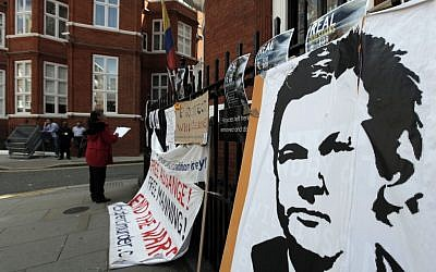 Placards and messages placed by supporters of WikiLeaks founder Julian Assange outside the Ecuador Embassy in London in late June, where Assange attempted to gain political asylum. (photo credit: Lefteris Pitarakis/AP)