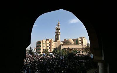 Palestinian Hamas supporters attend Friday prayer at the Islamic University in Gaza (photo credit: Wissam Nassar/Flash90)