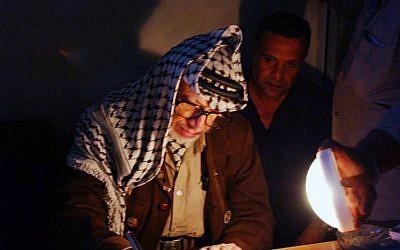 Palestinian leader Yasser Arafat in the Muqata'a in 2002. (photo credit: Palestinian Authorities via Abed Rahim Khatib/Flash90)