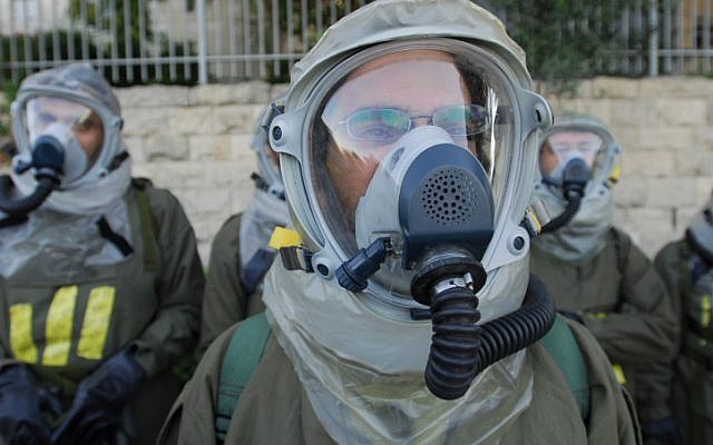 IDF Home Front Command soldiers wearing chemical protection gear participate in a drill simulating a chemical missile attack in July 2009. Sources in Damascus warned that an Israeli strike on Syrian chemical weapons depots will prompt their use in an non-conventional war. (photo credit: Gili Yaari/Flash 90)
