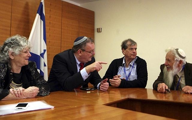 File: Former science minister Daniel Hershkowitz (second from left), in an unusual meeting in July 2012 with Israeli Nobel laureates. Participants included Ada Yonath (left), Aaron Ciechanover (second from right), and Israel Aumann (right). (photo credit: Gil Yohanan/Flash90)