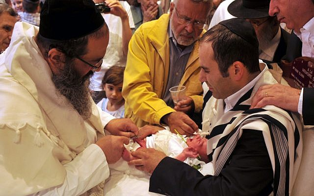 Illustrative photo of Jews performing a religious circumcision. (Serge Attal/Flash90)