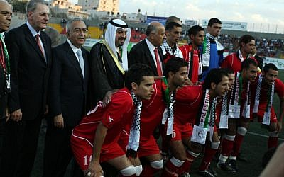 A friendly match between Jordan and Palestine (red) during a visit by the President of the International Olympic Committee (IOC) Jacques Rogge in Ramallah on October 5, 2010. (photo credit: Issam Rimawi/Flash 90)