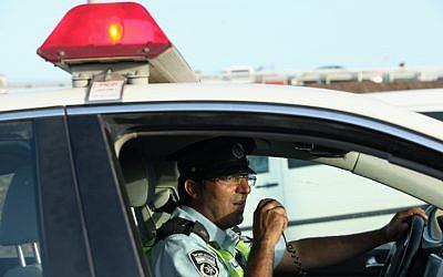 Illustrative photo: Traffic policeman at work. (Moshe Shai/Flash90)