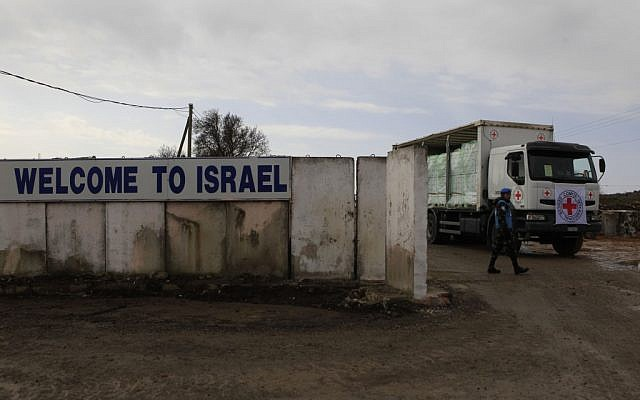 A truck at the Quneitra crossing between Israel and Syria in 2011. (photo credit: Tsafrir Abayov/Flash90)