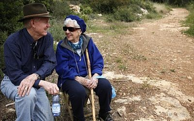 Illustrative photo of an elderly couple taking a walk in the Jerusalem Forest. (Miriam Alster/Flash90)