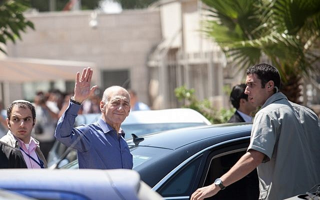 Ehud Olmert leaving court on Tuesday. (photo credit: Noam Moskowitz/Flash90)
