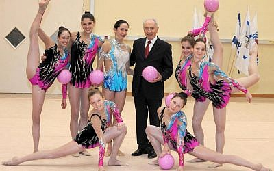 Shimon Peres and Israel's Rhythmic Gymnastics team, January 2012 (photo credit: Mark Nayman/Flash90)