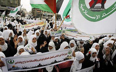 Palestinian female students protest in Rafah, Gaza Strip in February (photo credit: Abed Rahim Khatib/Flash90)