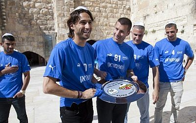 Hapoel Ironi Kiryat Shmona soccer players visit the Western Wall in Jerusalem after winning the national championship in April, 2012. (photo credit: Yonatan Sindel/Flash90)