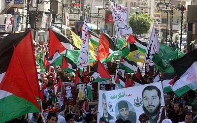 Hamas supporters hold a rally in the West Bank city of Ramallah in May (photo credit: Issam Rimawi/Flash 90)