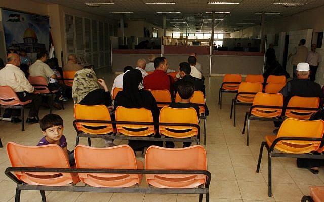 Palestinians wait at the Rafah border to cross into Egypt (photo credit: Abed Rahim Khatib/Flash90)