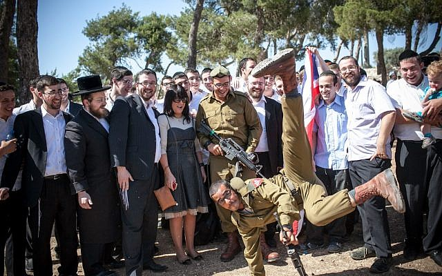 Religious Jewish soldiers attend a swearing-in ceremony as they enter the haredi IDF 'Nahal Haredi' unit (photo credit: Noam Moskowitz/Flash90)