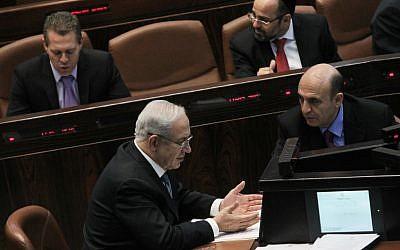 Prime Minister Benjamin Netanyahu speaks with Kadima chairman Shaul Mofaz in the Knesset plenum on June 4, 2012. (photo credit: Miriam Alster/Flash90)