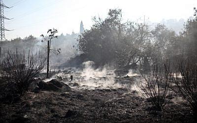 The smoldering fire outside Jerusalem last month. (photo credit: Noam Moskowitz/Flash 90)