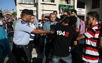 Protesters clash with police in Ramallah Sunday (photo credit:  Issam Rimawi/FLASH90)