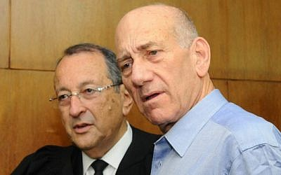 Former prime minister Ehud Olmert (right) with his attorney at the Tel Aviv District Court in early July (photo credit: Yossi Zeliger/Flash90)